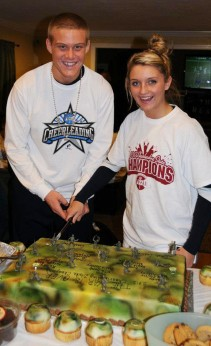 Captains Tyler Lewis and Macayla Sheehan cut the victory cake!