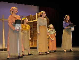 Molly Hurley, Genesis Rojas, Ms. Jen Hartnett, Sarah McLellan and Molly McLellan are Golde and Tevye's daughters in Fiddler on the Roof.