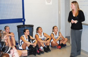 The Rockland girls basketball team in pre-game  locker room talk with Coach Diana Mitchell