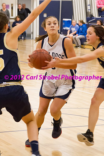 Kyra Rose goes to hoop against EB earlier this season.  photo by Carl Strobel
