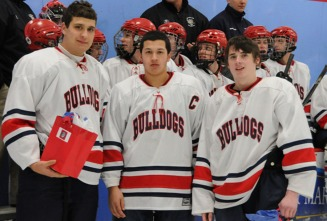 Left to right are seniors Chris Carchedi, Owen Lund and Chris Tanner. The hockey team's senior night was truly a momentous occasion as the Dogs defeated previously unbeaten Abington in an exciting game by a score of 2-1.