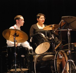 Ian Haas, another percussion leader, and Lydia Guerrero while preparing for the show