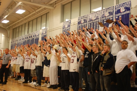 Bulldog fans use spirit fingers to wish players luck during foul shots