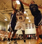 Tyler Gibosn goes up for the rebound.
