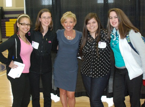 RHS students posed with TV personality, Kim Carrigan, who led the panel discussion at the Leadership Conference held at Curry College on Tuesday, March 12.