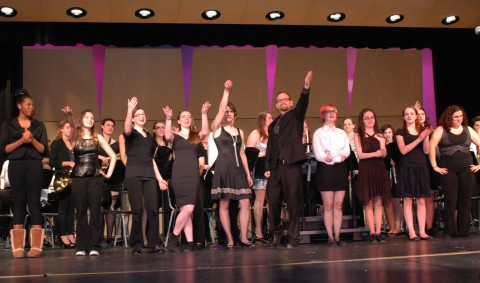Band and Chorus, led by Mr. Harden, take their final bows photo by Sami Murray