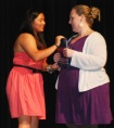 Leah O'Bryan presents yearbook to Ms. Walsh photo by Molly Hurley