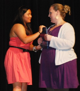Leah O'Bryan presents yearbook to Ms. Walsh. photo by Molly Hurley