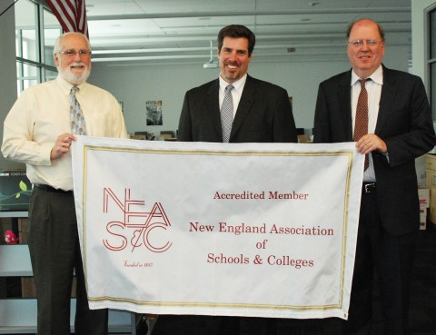 Asst. Supt. Mr. Scarpelli, RHS Principal, Mr. Cron and Supt. Mr. Retchless announce to the faculty NEASC Accreditation.