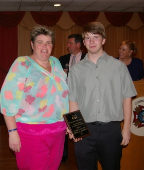 Dean of students Ms. Paulding gives Nick Demarco his Tech. Ed award