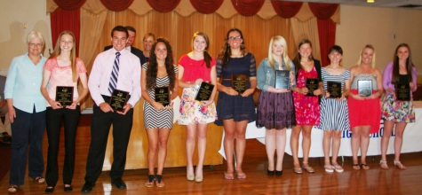 English teacher Mrs. Amy Woodward presented plaques to multiple award winners at the academic awards banquet. Left to right: Danielle Whitcher, Dennis McPeck, Alex Pigeon, Kara Penney, Caroline Kilduff, Haley McCray, Lexie Carchedi, Lauren Scott, Jackie Carlson and Erin Mulready.