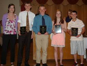 English teacher Ms. McDonough presents the music awards to Marcus Rohwetter, Ian welch, Ella Engle, and Mark Ewell