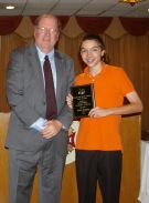 Superintendent of Schools Mr. Retchless presents the Overall Academic Achiever Award to Grade 9 student Ryan Sugrue.