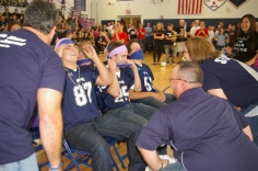 Senior boys participating in a game. While Senior Billy Brady gets kissed on the cheek by math teacher Mr. Liquori.