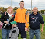 Goalie Matt Nicholson with his parents.