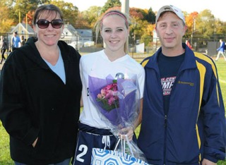 Taylor Lambrinos and her mom and dad, Erin and Scott.