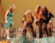 "Mowgli ""monkeys around"" with the monkeys played by Catherine Crocker, Rebecca Portela and Brittiana Garcia."