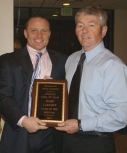 Mark Laramee, Class of 1998, was a four time state champion in wrestling and twice won the title of All-New England. He is shown here with wrestling coach, Tim Cullinan.