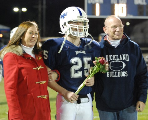 Senior captain Colin Aylward and his mom and dad.