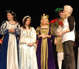 Mrs. Woodward, director of the Shakespeare Festival receives poinsettas from her cast.