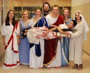 The cast of Julius Caesar, Left to right: Lulu Lima, Julia Decenzo, Leah Dececco, director Mr. Neal, Chris Catania, Sarah Laleme, Kylie Langhoff and Sean Vo.