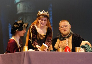 Kaitlin Mott, Olivia Olsen and John Mott in the banquet scene from Macbeth