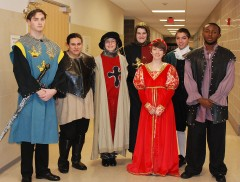 The cast of Henry V: Left to right: Pearse McNally, Chrissy Daly, Lisa Howes, Chris Landy, Danielle Hill, Ryan Sugrue, and John Kamande.