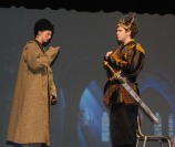 The first murderer (Erin Mulready) tells Macbeth (Zach Murphy) that Banquo is dead.