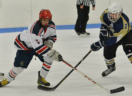 Shawn Kane battles for the puck.  He had a hat trick against EB.  photo courtesy of Rockland High School Sports