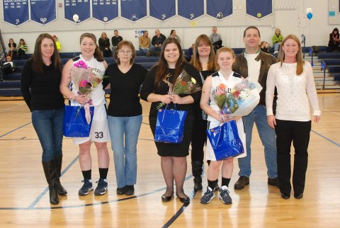 Senior Ally Cerrato (left) with her mom and grandmother, Georgia Panagiotidis (center) and Sami Murray with her mother and father were recognized by Coach Diana Mitchell at the girls last regular season home game.