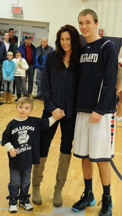 Luke Quersher with his mom and brother.