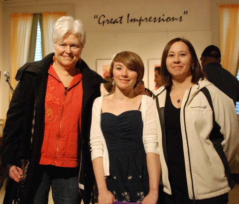 English teacher Ms. Amy Woodward with Danielle Hill and her mother