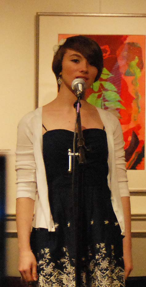 Hill reciting one of her poems at the regional competition