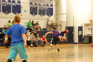 Purple Cobra and baseball player Matt Nicholson uses his pitching skills on the way to victory against the RMS team