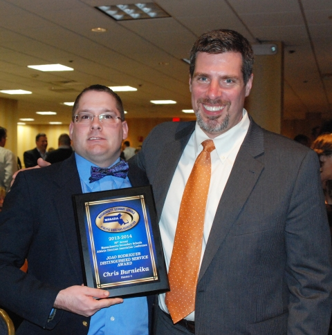 Dr. Cron and Chris Burnieika at the banquet where Chris received his award.