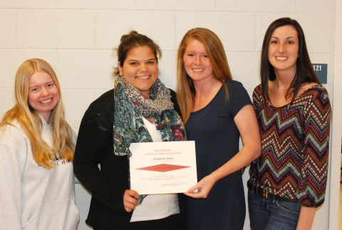 Victoria Pratt, Georgia Panagiotidis, Molly Garrity and Devin Gilmore with their Special Achievement Award from the New England Scholastic Press Association.