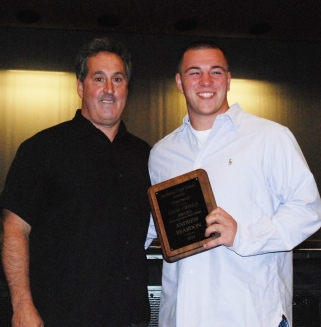 Andrew Reardon received an award from AD Gary Graziano