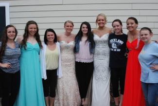 Softball team players Angela Turner, Taylor Reis, Kylie Langhoff, Kaitlyn Capeau, Abby Kinlin, Brianna Starkey, Maddie Olsen, Makenzi Buckley and Sami Murray