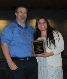 Track Coach Randy Grimmett presents an award to Georgia Panagiotidis