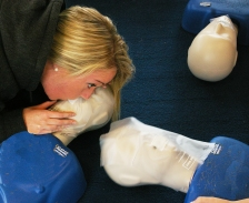 Jackie Carlson practicing her resuscitation breaths for adult CPR. Photo by Georgia Panagiotidis
