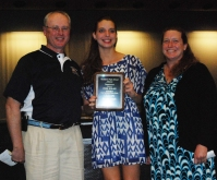 Lilly Margolis received an award from her coach Robert Murphy and her coach and mom Mrs. Margolis