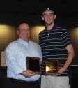 Matt Nicholson received an award from his baseball coach Nick Liquori