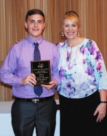 Freshman Adam Royle received his Multi-Winner Academic Achievement Award for Health and Technical Education from Asst. Principal Sue Patton.
