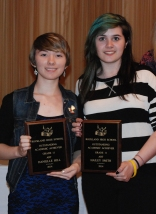 Juniors Danielle Hill and Hailey Smith holding their Grade 11 Art Achievement Awards.