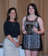 Sophomore Kaleigh Pishkin holding the Family Consumer Science Award for Grade 10, presented by Mrs. Fleming.