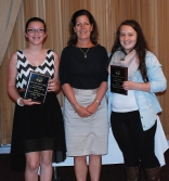 Freshmen Isabelle Pica and Meghan Saucier holding the Family Consumer Science Award for Grade 9 presented by teacher Trish Fleming.