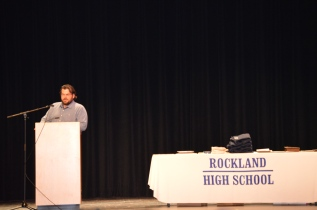 English teacher Chris Neal accepts a yearbook from the Class of 2014, which was dedicated to him.
