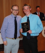 Music Director Matt Harden presented junior Ian Welch with the Music Department's Academic Achievement Award.
