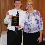 Junior Markus Rohwetter received a Math and Music Academic Achievement Mulit-Winner Award, presented by Assistant Principal Susan Patton/