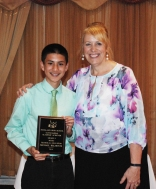 Freshman Michael Belmonte received his Multi -Winner Award in Music and Technical Education from Assistant Principal Sue Patton.